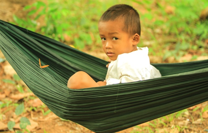 We saw this child sleeping in a hammock  with him mother at the beginning of the hike. There were several butterflies flying all around him.