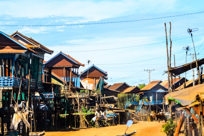 Stilt houses along the narrow road.