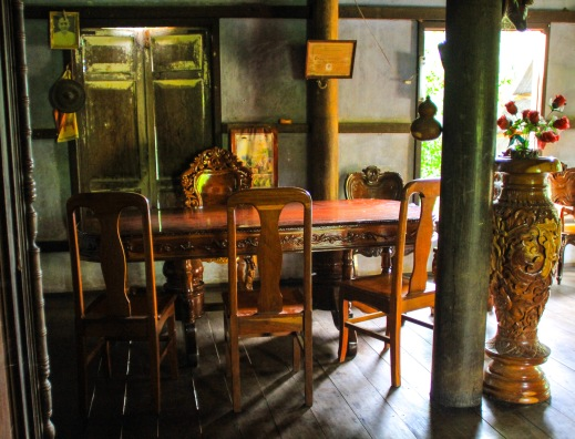 Dining room table.  This kind of ornate and heavy furniture is what most Cambodians buy for their homes