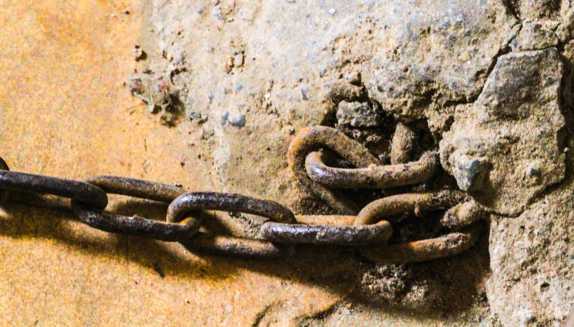 Chains in the wall to hold the prisoners.