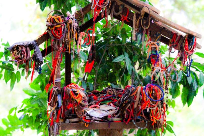 Spirit House with monk blessed string bracelets.