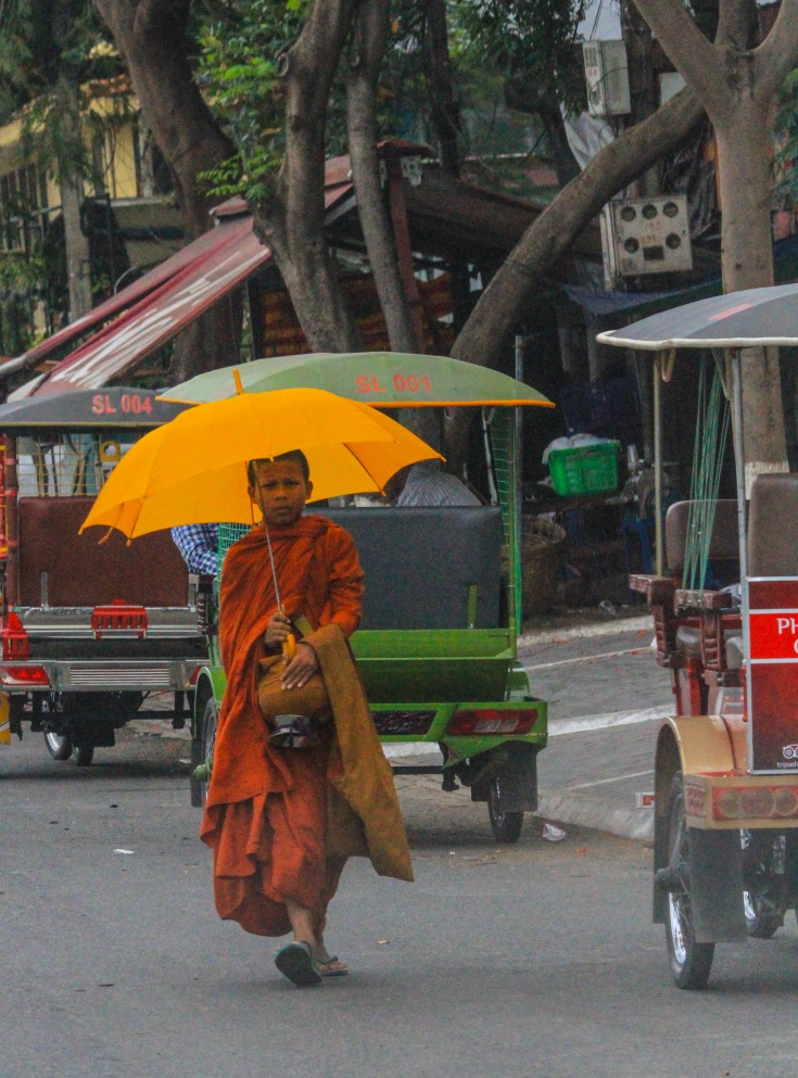 Monk with sun shade.