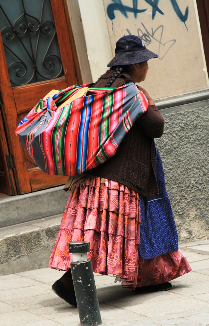 Woman with her bundle. You see these bundles carried every where.