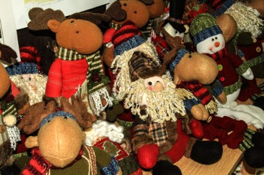 Stuffed dolls for sale in the shop.